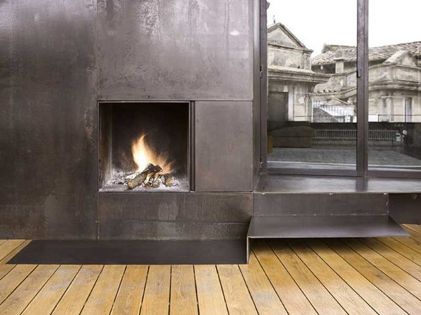 Rustic european fireplace iron a guys room masculine pinterest - Cheminee metal design ...