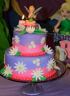 Tink fairy / pixie cake.. beautiful. Sml Tinkerbell figurine on top.