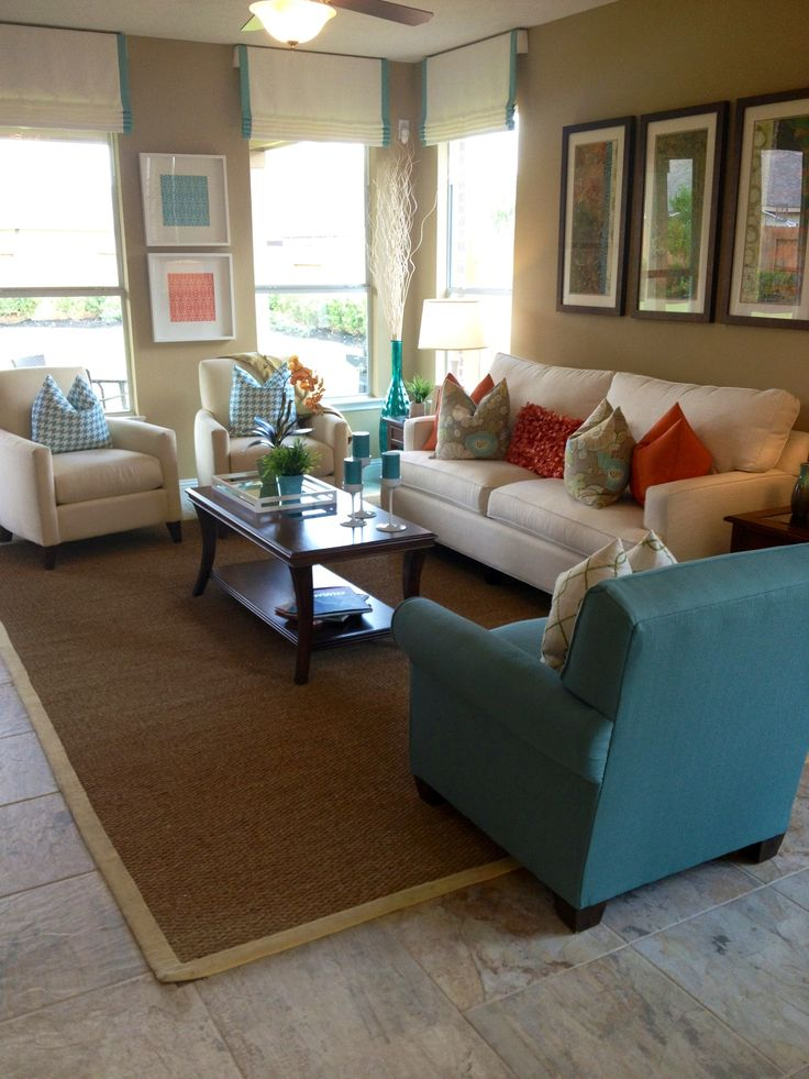 Blue and coral living room decor beach house pinterest for Coral living room ideas