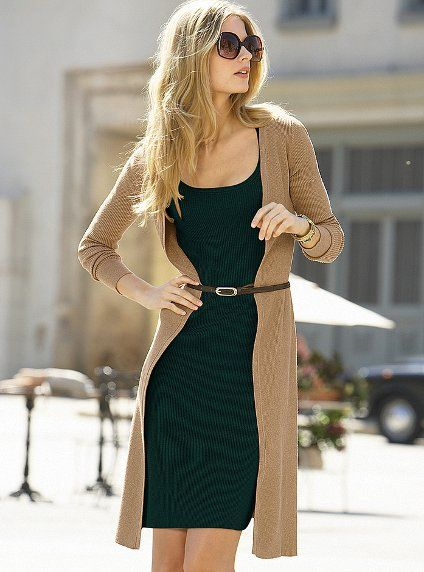 Long sweater with belt over mini skirt dress