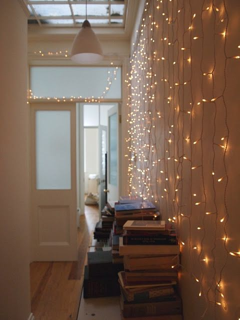 entryway with fairylights - oh yes! when I paint the hallway and make it all lovely, this will make a gorgeous finishing touch :)