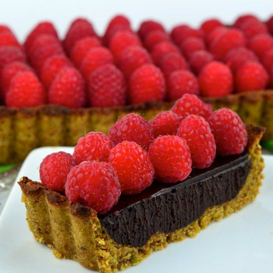 ... pistachio almond crust. The perfect vegan chocolate raspberry tart