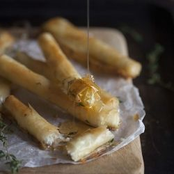 Baked goats cheese cigars with honey and thyme.
