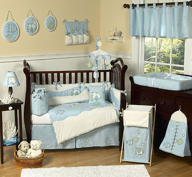 Your baby will drift asleep dreaming of the seas in this for Fishing crib bedding