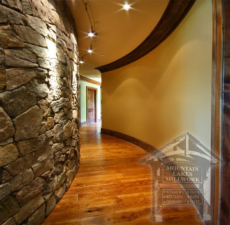 Curved hallway with stone wall accent mountain view for Stone accents