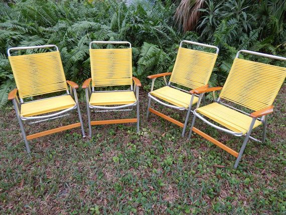 Sunny yellow lawn chairs by telescope comfy metal patio for Outdoor furniture yellow