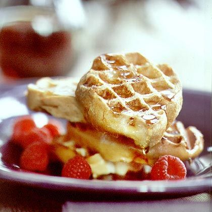 French Toast Waffles Cook milk-and-sugar coated French bread slices on ...