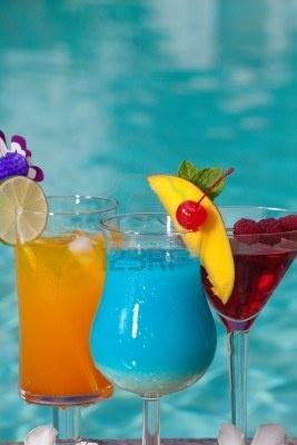 Mai Tai, Blue Hawaiian, and Cosmopolitan cocktails on swimming pool ...