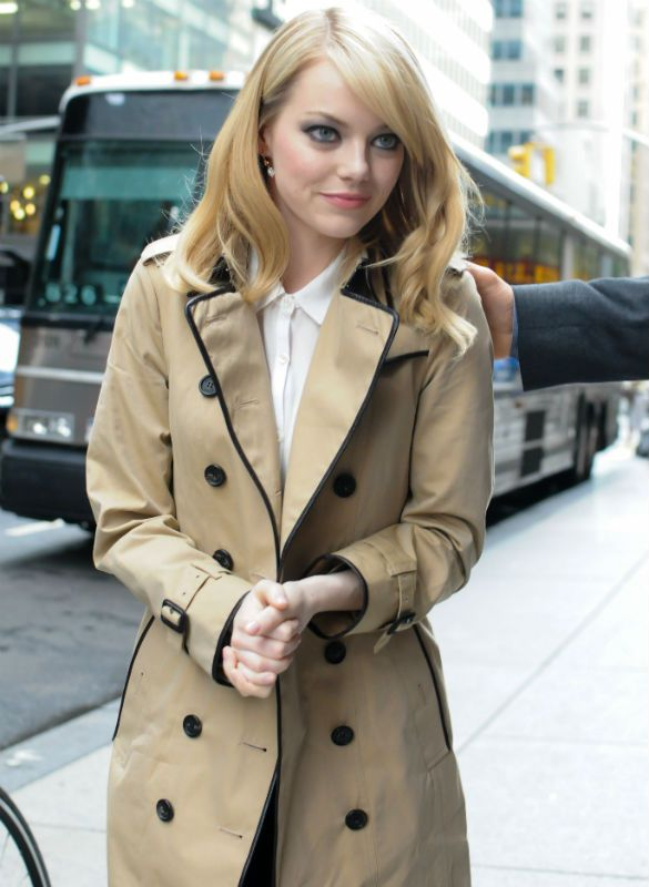 Emma Stone in a tan Burberry trench coat.  LOVE the black piping! Super cute outfit.