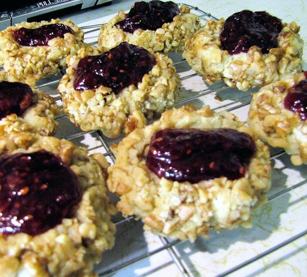 Thumbprint Cookies rolled in chopped walnuts and filled with even more ...