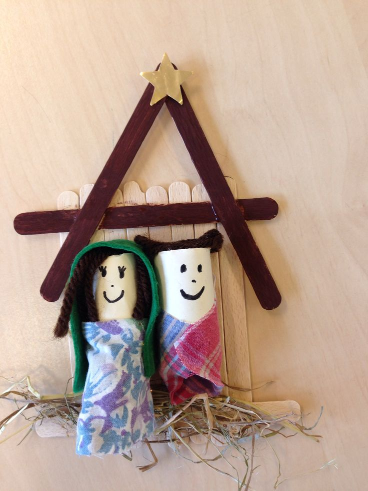 Nativity scene made of popsicle sticks, corks, wool and fabric.
