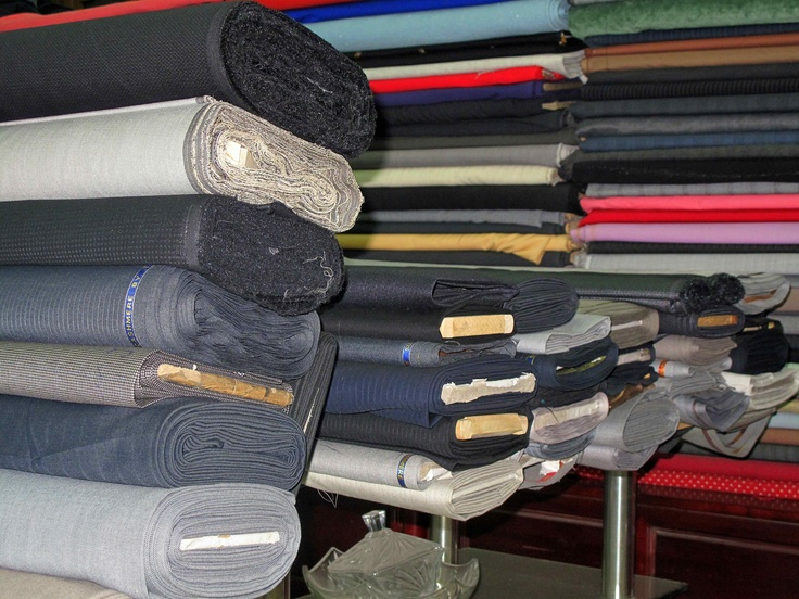 Mountains of fabric ready to be created into suits, vests, trousers, suit linings and dresses. All of our fabric is created following centuries trusted techniques from Italy and England.