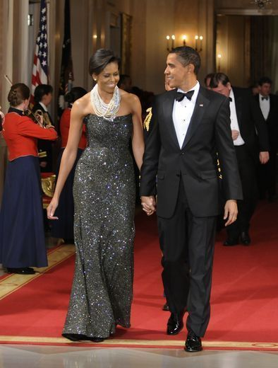 Peter Soronen does it again, this time in a sparkling strapless gown. Michelle Obama tops her best look generously with pearls. http://bit.ly/wOnhHN