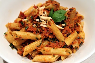 Sun-dried tomato pesto over pasta with pine nuts and almond slivers. I ...