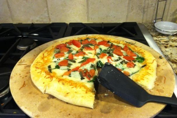 Margarita/caprese pizza. 1 tbsp of Olive oil is good.