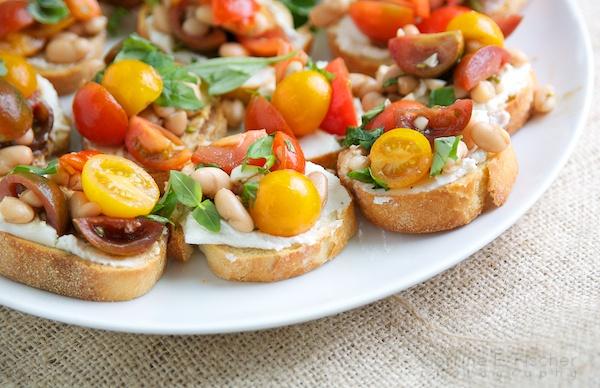 White Bean & Heirloom Tomato Bruschetta   makes my tummy growl...grrr ...