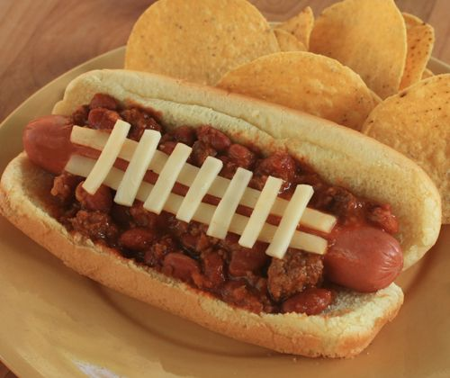 Chili hot dogs! Dress them up like a football and enjoy with Sutter Home Zinfandel