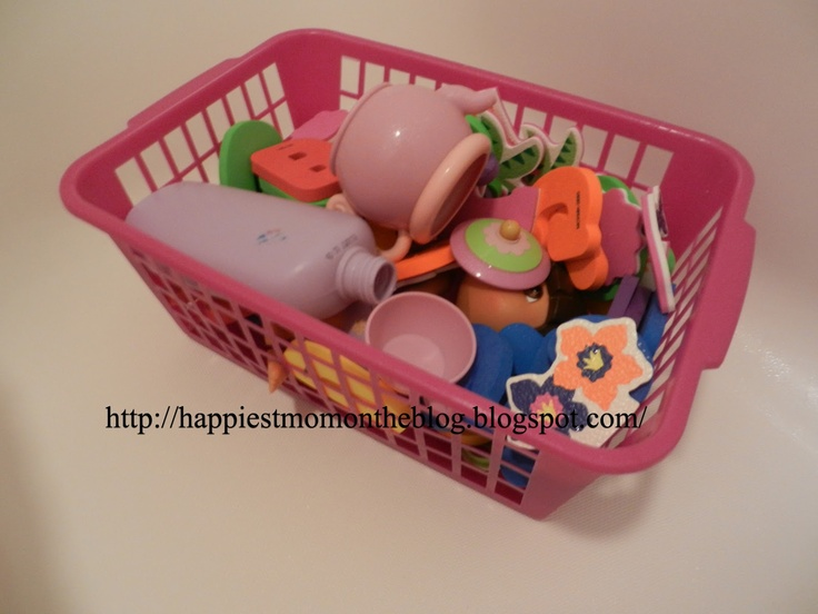 Make your own bath toy holder . . . drill holes on bottom of basket