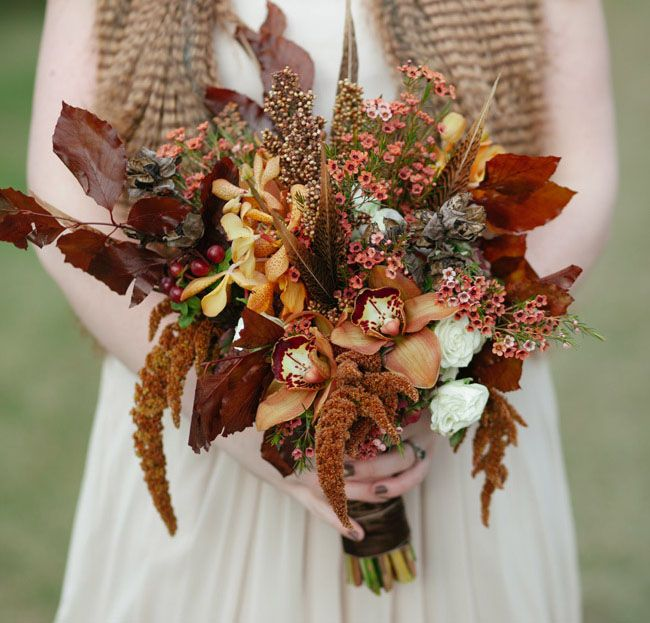 the most gorgeous autumn wedding bouquet!! love the rusty red/orange color {cedarwood rustic fall bouquet}