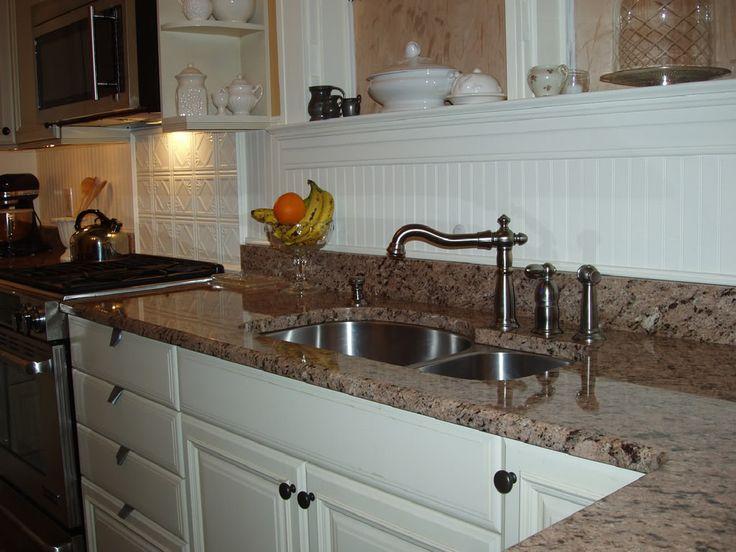 beadboard backsplash with metal tiles behind stove kitchen