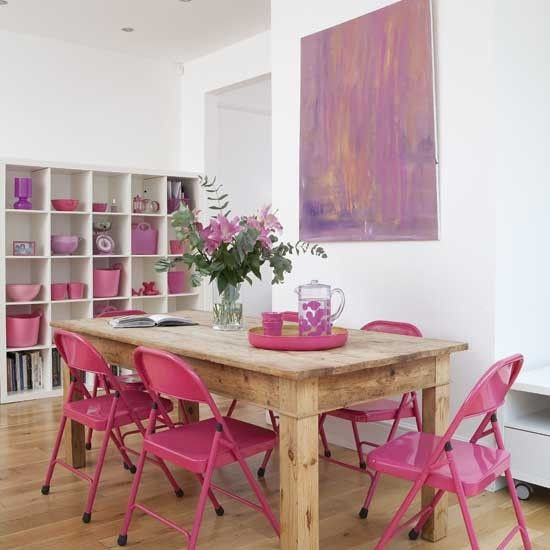 Proof that paint makes anything better: Check out how much more chic these metal folding chairs look with a coat of hot pink paint! #diy #paint