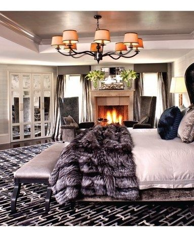 Big comfy bed with a fur throw and a roaring fire! Oh how I wish for this!