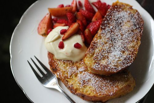 Challah french toast with macarated strawberries by honey drizzle on ...