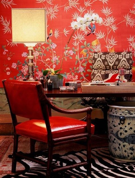 Red Rooms: Decorating With the Color Red - Red chinoiserie wall paper, ikat, animal print and a red leather chair in a home office