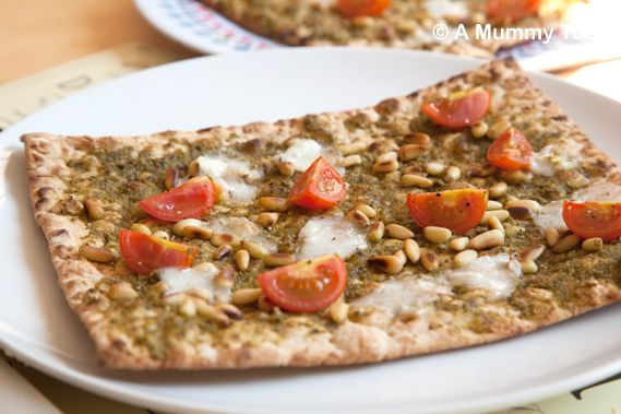 Pesto pizza with toasted pine nuts, goats cheese and cherry tomatoes ...