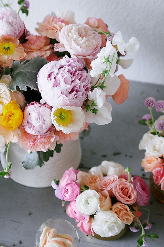 Peonies, poppies, roses, ranunculus.