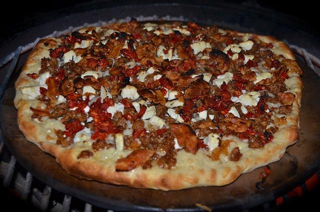 Necessary Indulgences | Spicy Sausage & Caramelized Onion Pizza