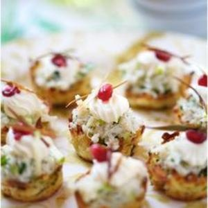 ... apple & crab salad topped with a jewel-toned pomegranate seed. From