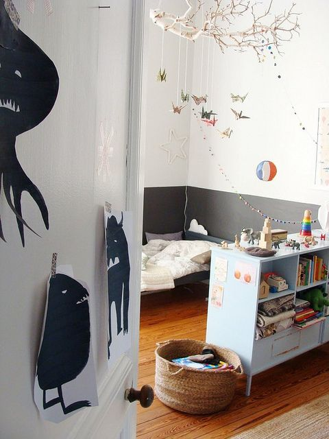 love the monsters on the wall in this kids room