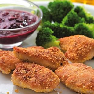 Need an easy dinner tonight? Try this healthy version of chicken nuggets. Tossing chicken tenders with cornmeal   gives these chicken nuggets great crunch without deep-frying. Blackberries   (or raspberries, if you prefer) combined with whole-grain mustard make for a   sweet-and-savory dipping sauce. Serve with: Steamed broccoli and carrots. @EatingWell