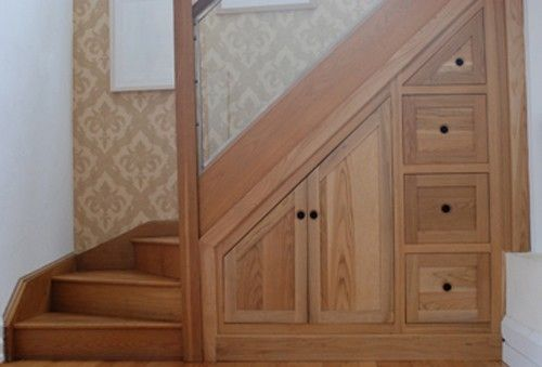 cabinet and drawers under stairs hall stairs and