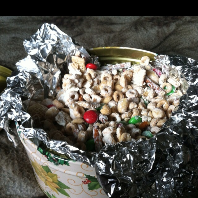 Reindeer chow chow... Cheerios, chex mix, pretzels, mms all drizzled ...