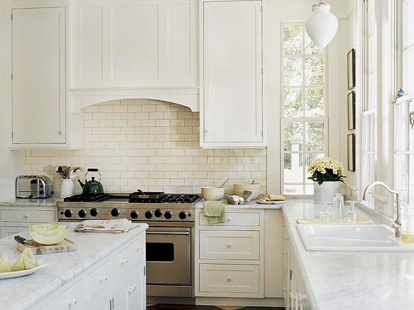 Arch over range, countertops, tall cabinets, subway backsplash