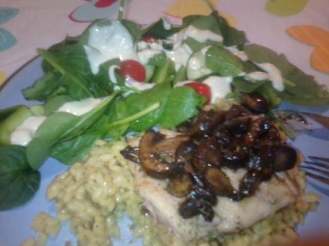 Mushrooms and rosemary chicken on top of mushroom risotto with a ...