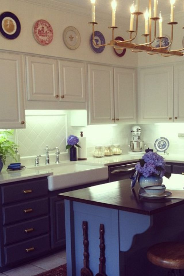White upper cabinets, blue lower cabinets