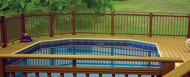 Keystone semi-inground swimming pool with wraparound deck