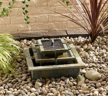 solar water fountain and stones outdoor room pinterest
