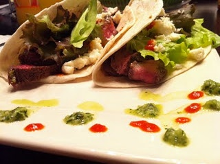 Spicy cilantro lime marinated flank steak tacos. Super easy