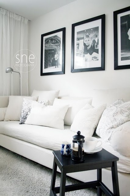 big framed black and white prints for big wall behind couch