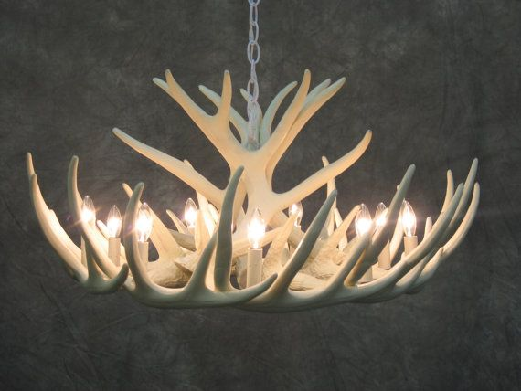 Faux antler chandelier for the dining room.