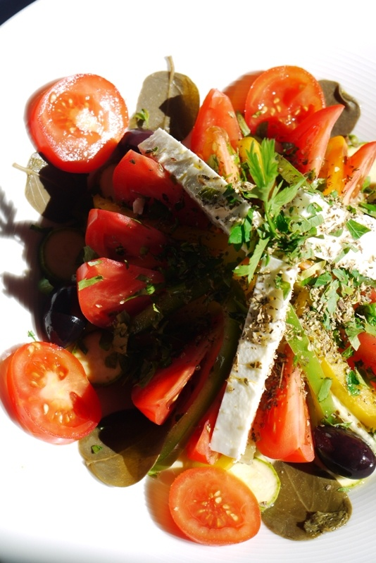 Greek salad with rusk barley bread, tomato, cucumber, peppers, capers ...