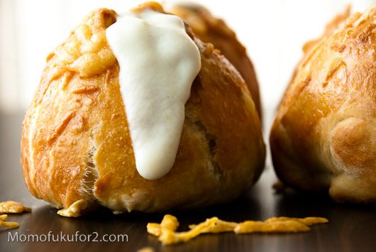 ... roll stuffed with caramelized onions, scalloped potatoes, and cheese