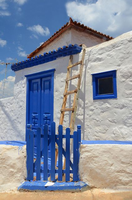 Blue door and fence, Greece.