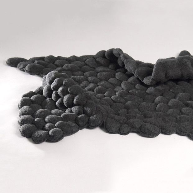 Pebbles Carpet  by Neora Zigler //    A carpet of pebbles, literally. Each pebble is individually sewn into the fabric to form the carpet.