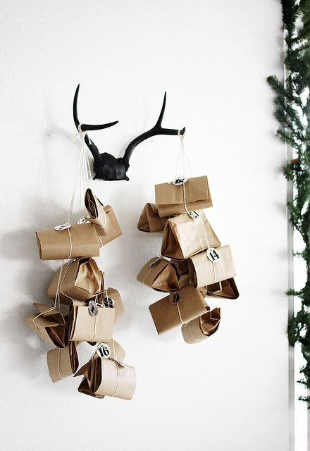 DIY Advent Calendar by AMM blog - I'm thinking of doing this with Christmas Cards hanging off them