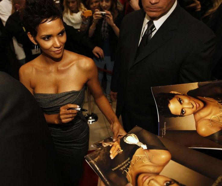 Halle berry signs autographs following her arrival in warsaw to